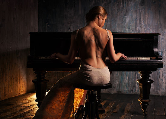 Naked Musicians supply your party or event with talented male musicians in the buff and female musicians in lingerie for any event and occasion. We are a semi naked musicians agency for stag do's, hens parties, girls nights, birthdays, pool parties, divorce parties, dinner services, weddings, cocktail bars and whole host of events and parties across the United Kingdom. Professional female pianist playing the piano.