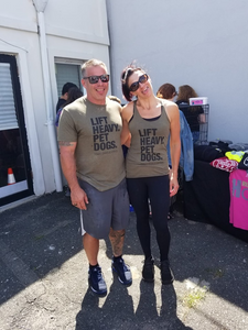 lift heavy pet dogs shirts on participants of woodmere fitness center's third annual deadlift for dogs event