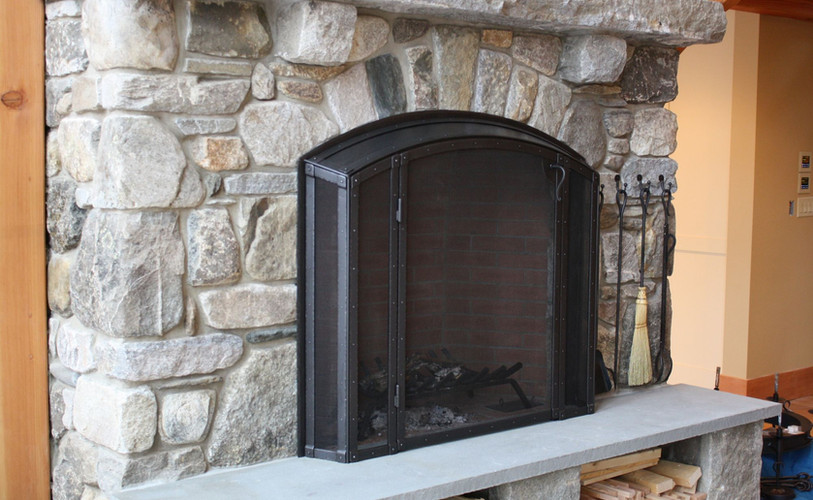 Stone Fireplace with Built in Firescreen