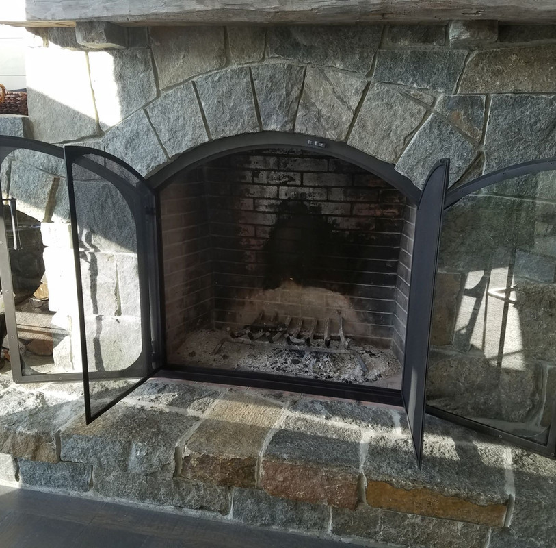 Fireplace with Glass and Screen Doors