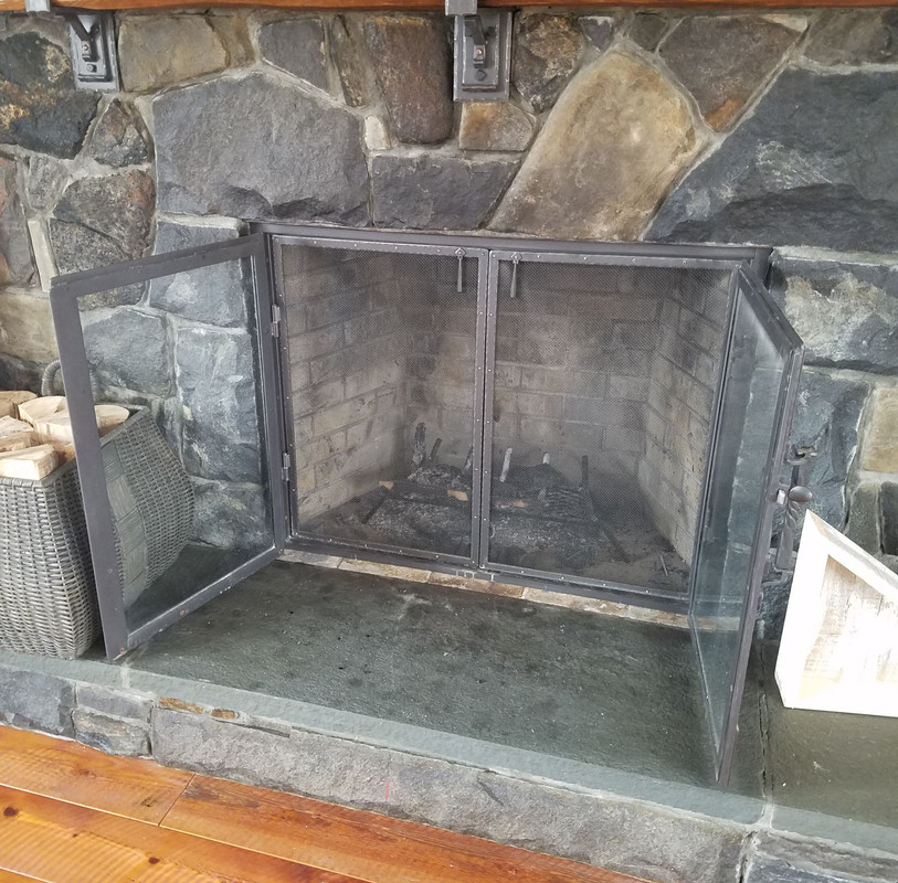 Glass Fireplace Doors with Screen Behind