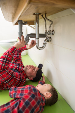 father and son plumbing, Father and son at work