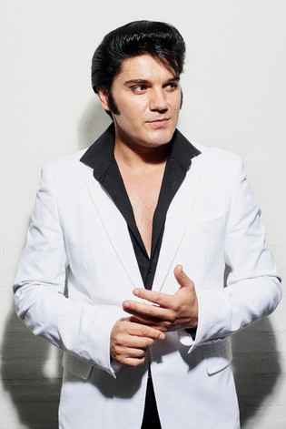 Eddy Popescu, 40. Romania Back in Romania, I didn't have the chance to do my Elvis show. People like Elvis, but it is not like in the UK. My brother in law had moved to the UK and noticed that everybody loved Elvis. He called me and told me to come and give it a try. I left my band and bookings in Romania and decided to move with my wife in 2010. From the beginning, I had a feeling that I would stay in England, but it was very tough. I bought a small amplifier and a power generator and started singing on the streets. I was very shy in the beginning. I spent many hours in the rain and cold but after a while, people started booking me on the streets. Suddenly I became very popular in the area. I was awarded the best newcomer in a contest for all the agencies in Newcastle. My full-time job now is doing my Elvis show. I am booked every weekend throughout the year for both public and private shows.Everybody like Elvis. In the northeast of England, I would guess that I am the only ETA selling out shows. Any other artist is struggling.
