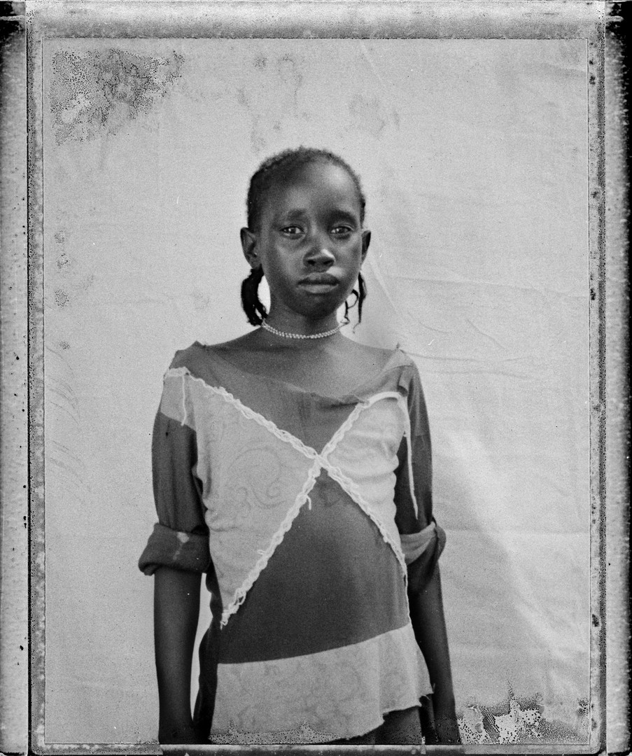 Name: Hala Adam. Age: 5 years. From: La Balatin, Sudan. Has been in Jamam: 5 months. The reason why she is in the refugee camp: Fled from the war in Sudan. She walked 1 week to get the refugee camp.