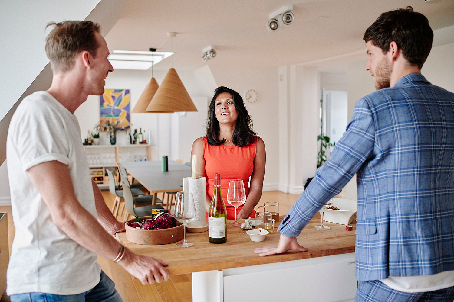 Paul Sephton(L) 28 y.o from South Africa, Saloni Deva(middle) 30 y.o from Sweden and Tim Aardenburg from the Netherlands having a tea and a glass of wine in their shared kitchen in one of lifeX apartments in the Østerbro neighbourhood in Copenhagen.