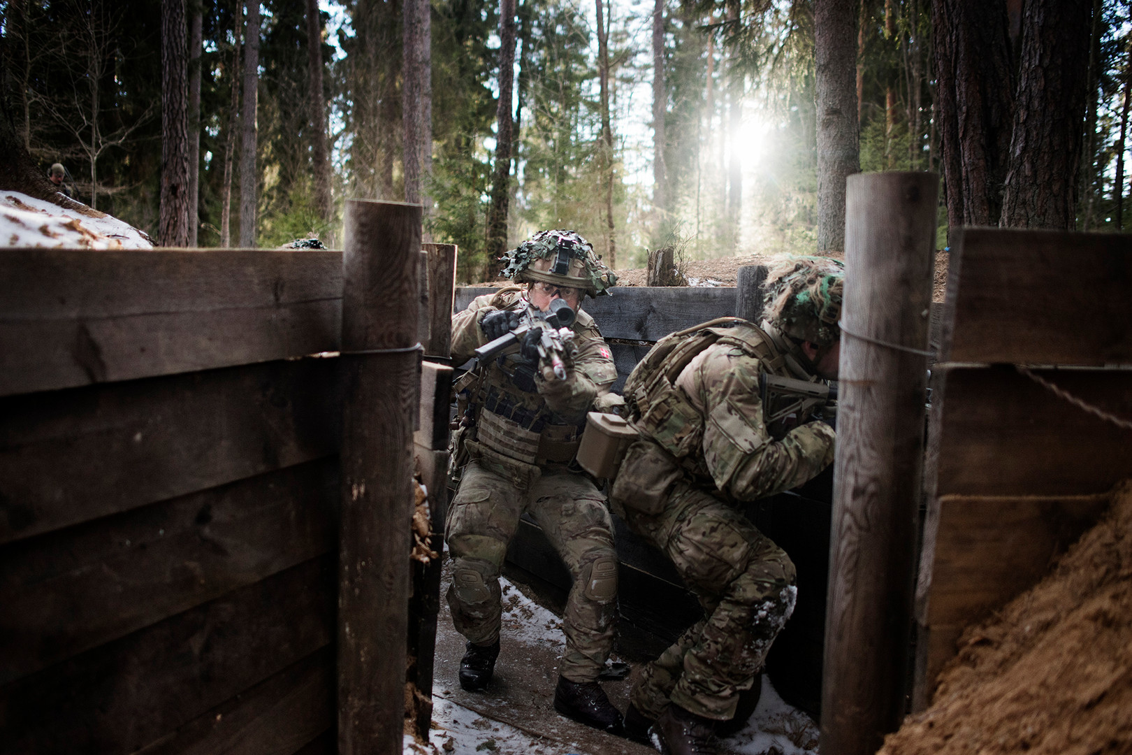 Soldier from Danish first Division of First Armored Infantry Company, during an exercise where a trench must be stormed and taken.