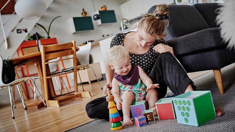 Rine Riskjær, 32 y.o, plays with her daughter Ronja Uld Riskjær, 1y.o, on the floor at the apartment in Lange Eng. The apartments at Lange Eng vary in size. The smallest apartments are 72 square meters and the biggest 128 square meters.  Lange Eng was designed by Danish architects Dorte Mandrup Architects.