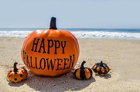 Beach and Ocean Happy Halloween background with pumpkin.jpg