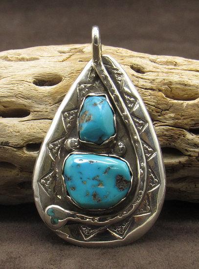 Effie Calavaza Sterling Silver Turquoise Snake Pendant
