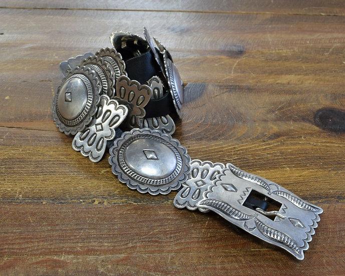 Vintage Southwestern Sterling Silver Repoussé Concho Belt