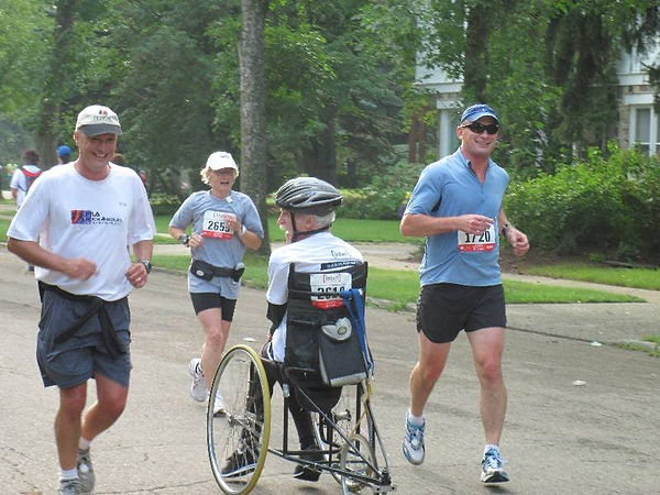 me run/wheeling in the 2010 half marathon with two friends on each side of me
