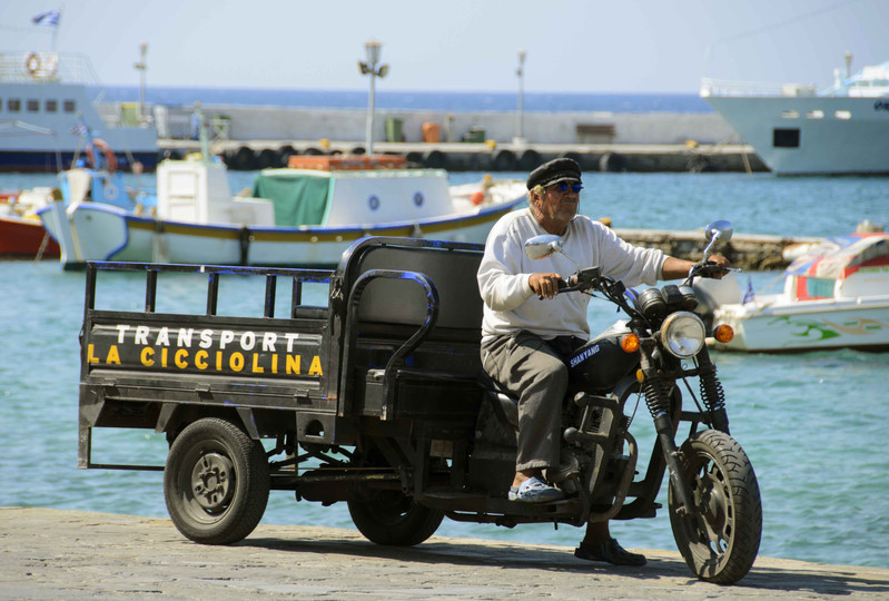 person delivery traditional mykonos cycl