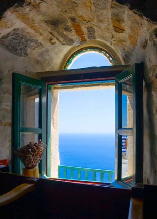 view window sea greece stone house copy.