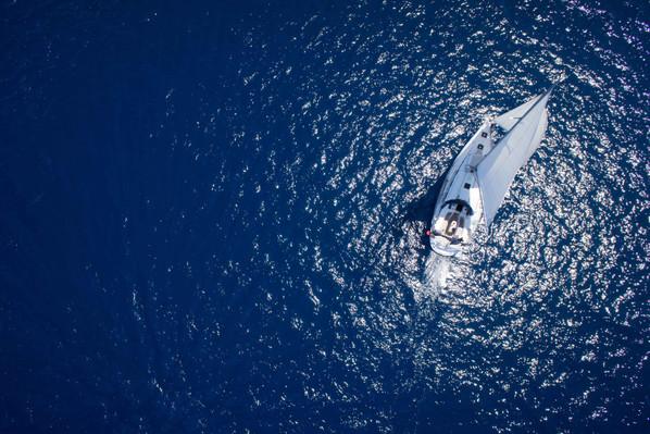 sailing blue aegean sail boat from high
