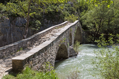 stone bridge greece river adventure road