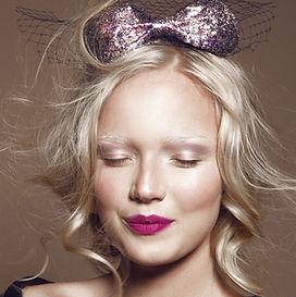 Flicka med Glitter Bow