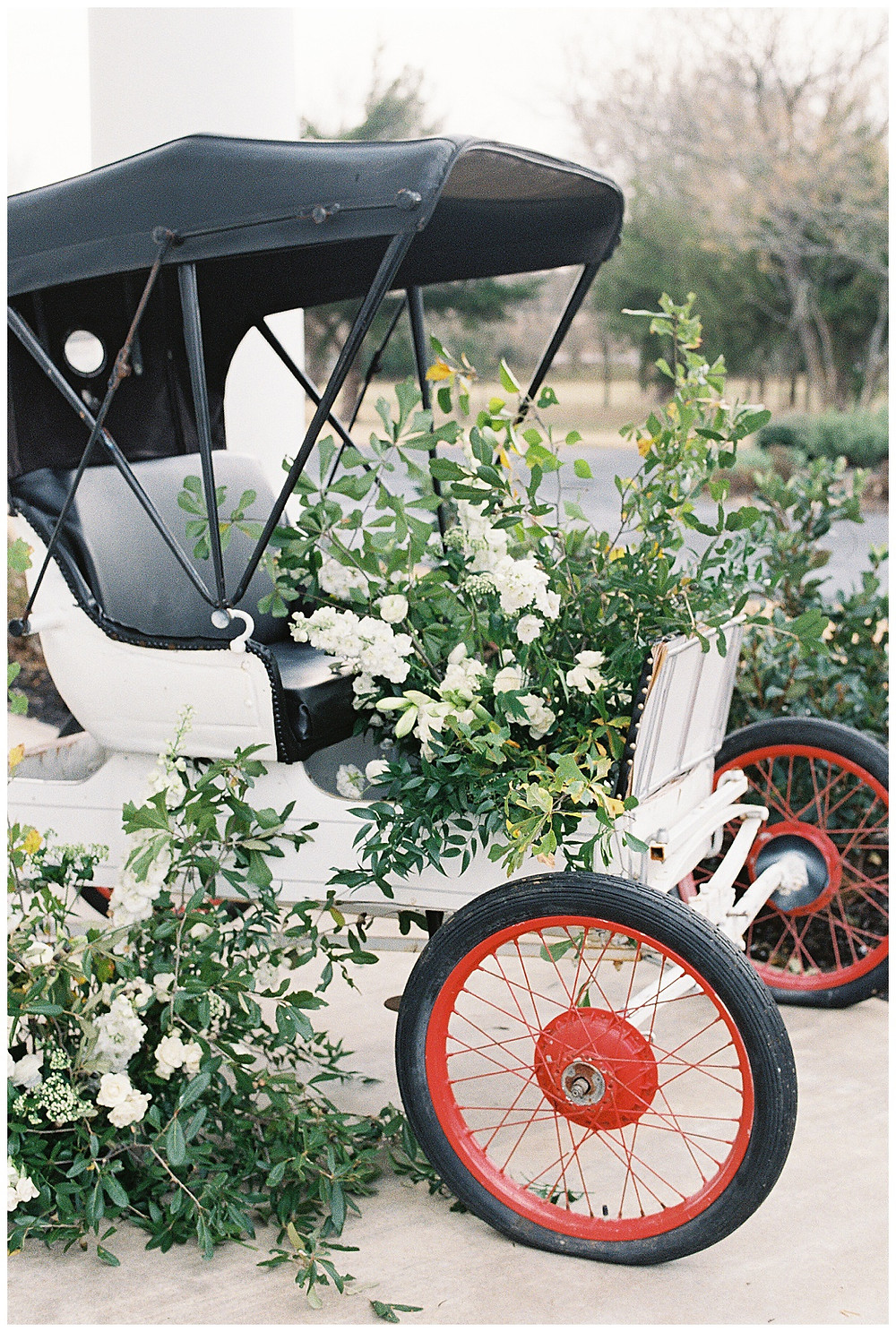 the pearl at sabine creek, dallas wedding photography, vintage buggy,  dallas wedding, spring, texas, floral installation  on getaway buggy. wedding exit buggy with flowers white yellow flowers