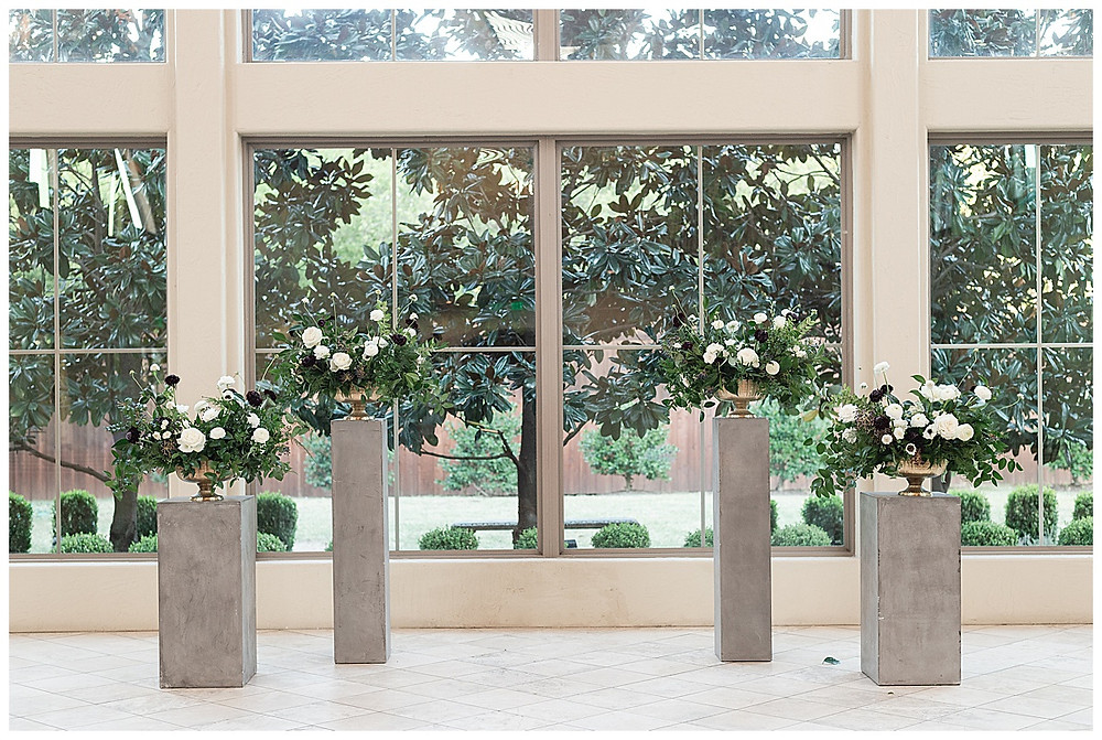 Chapel Ana Villa, The colony Texas, dallas wedding, dallas wedding photography, dallas wedding venue , concrete pillars with white roses and flower arrangements for ceremony
