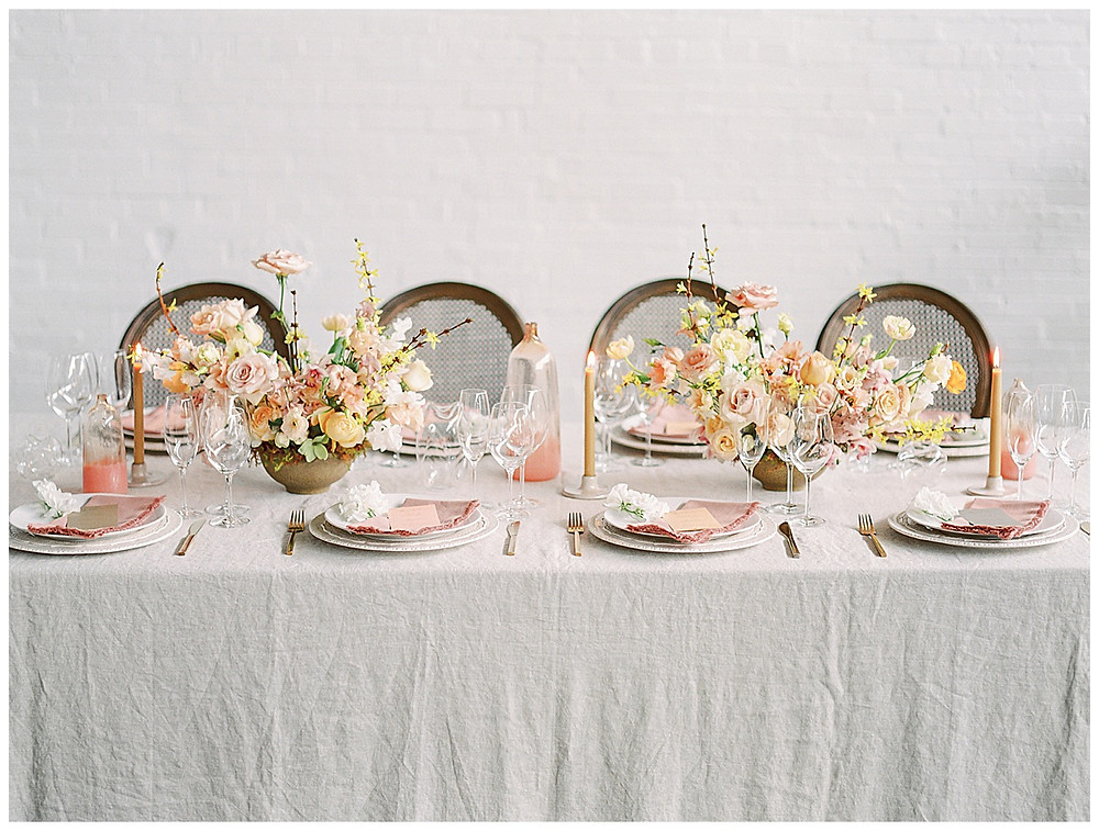 film photography , dallas wedding setting for eight people , table setting with yellow, peach, pink flowers, pink napkin, gold silverware, dallas wedding photographer, beatbox portraits, brown chairs, The Place At Tyler, Dallas Texas , dallas wedding photography