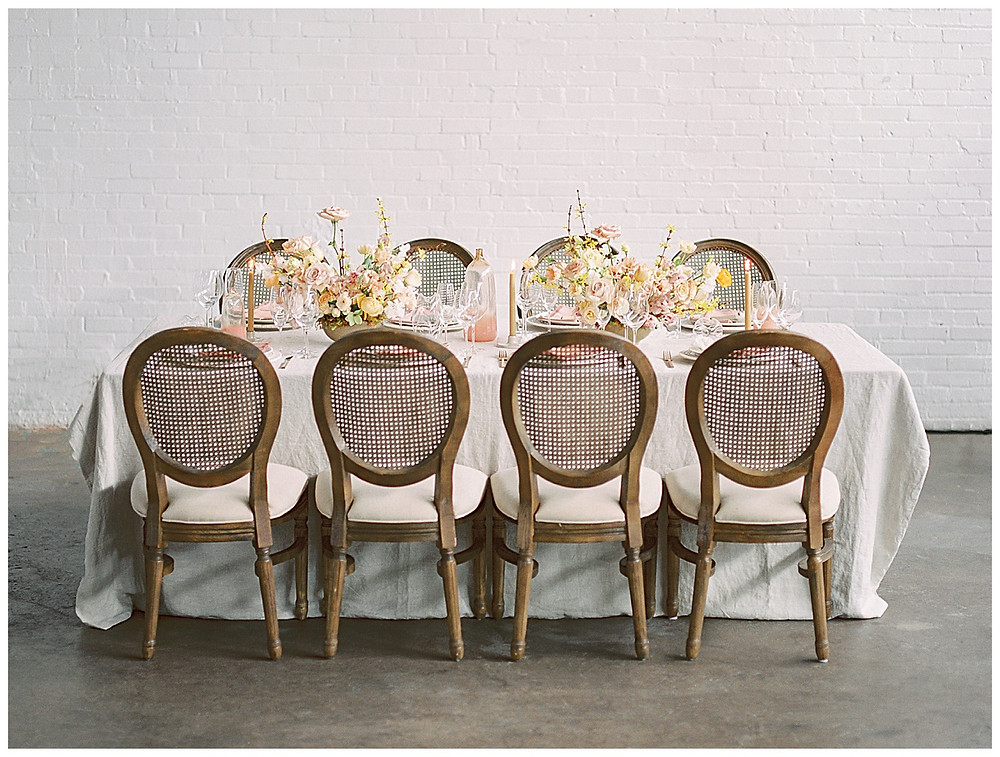 dallas wedding, table setting with yellow, peach, pink flowers, pink napkin, gold silverware, dallas wedding photographer, beatbox portraits, film photography , The Place At Tyler, Dallas Texas , dallas wedding photography