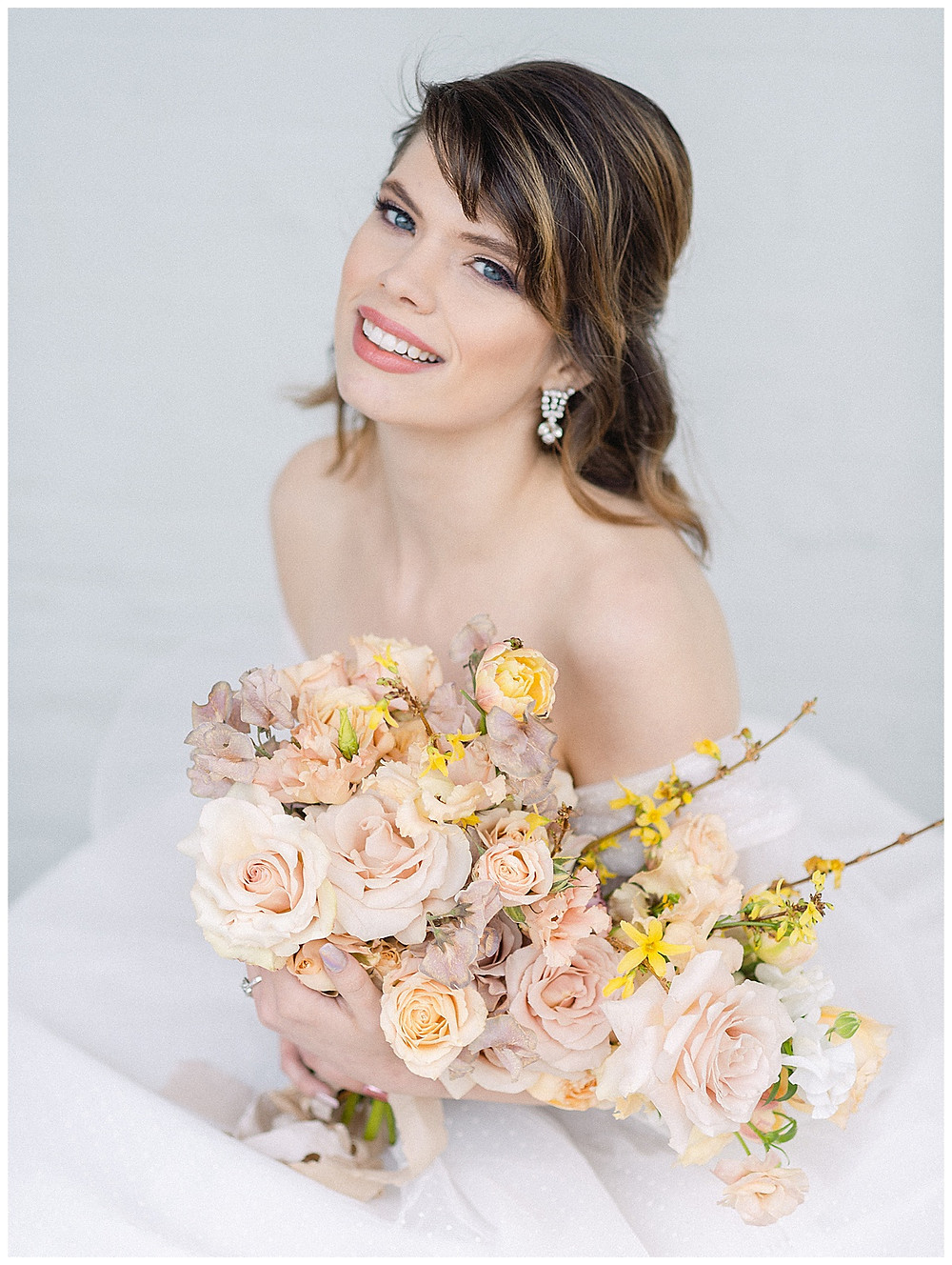 film photography, dallas wedding, bride holding bouquet with yellow, pink, white, green, peach flowers, sitting, The Place At Tyler, Dallas Texas , dallas wedding photography