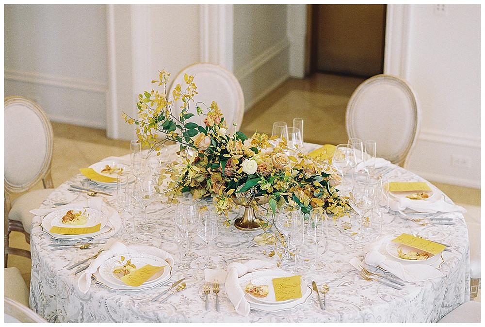dallas wedding photography, The olana hickory creek texas, yellow green, white wedding, summer/spring wedding. film photography, tables cape for ten, white plates, yellow menus, yellow arrangement  clear stemware