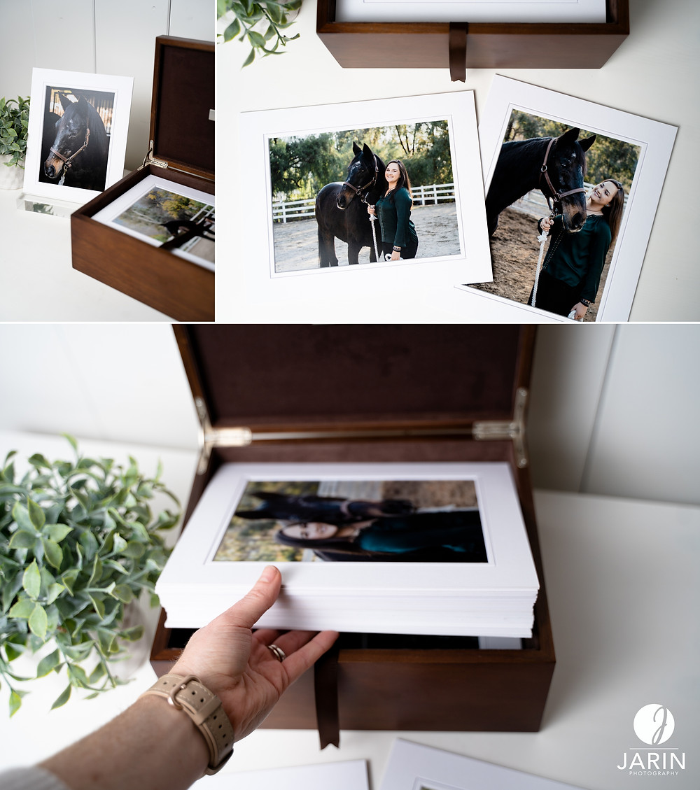 Photo prints inside of a wooden print box.