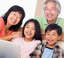 Asian family laughing and learning together.