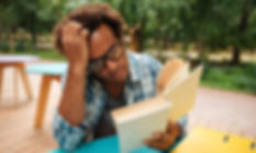 Black man concentrating on reading.