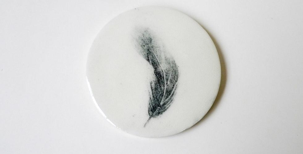 Plaque de porcelaine plume
