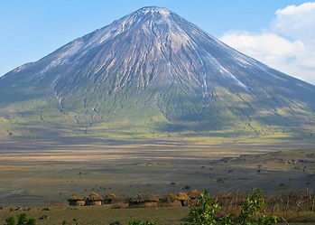 Maasai village in northern Tanzania below volcano in community hunting game-controlled reserve.