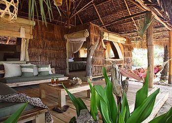 Che Shale banda interior made from local driftwood & Makuti, dried coconut palm, at Malindi, Kenya for big game sea fishing.