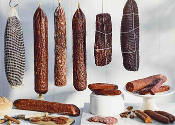Selection of wild boar meat, venison from deer & gamebird, hanging as sausage salamis form, healthy & high nutritional value.