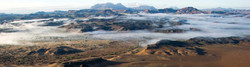Arial view of hunting concession in Damaraland, Namibia with low cloud in the foreground.