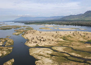 Mana pools of the Lower Zambezi Valley with the distant escarpment of Zimbabwe, bordering Conservation Hunting Concessions.