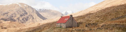 Remote shooting hill bothy used as a highland deer stalking hunting lodge in the grassy Scottish mou