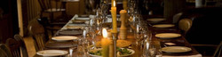 Shooting lunch dining table in hunting lodge, with candles & wine glasses for grouse day guests.