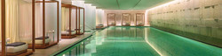 Spa indoor swimming pool for non-shooting & hunting guests in hotel, with individual bed awnings.