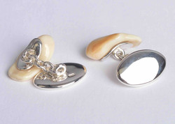 Red deer stag ivory tusk cufflinks displayed with sterling silver plates & underside hallmarks.