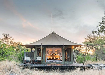 Onguma Bush Camp tent with wooden decking on a classic luxury safari organised by Sybarite Sporting for non-hunting guests.
