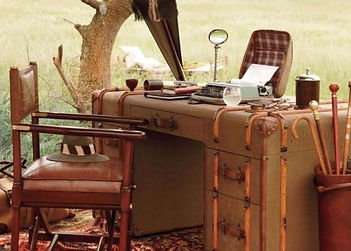 Sybarite Sporting hunting & shooting office in African bush safari camp, chair, desk & telephone available on 020 3196 1962.