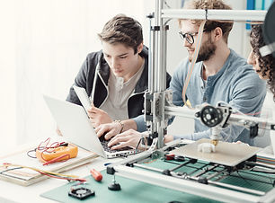 group-of-students-using-a-3d-printer-and