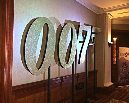 Gold Glitter 007 Logo Prop Hire