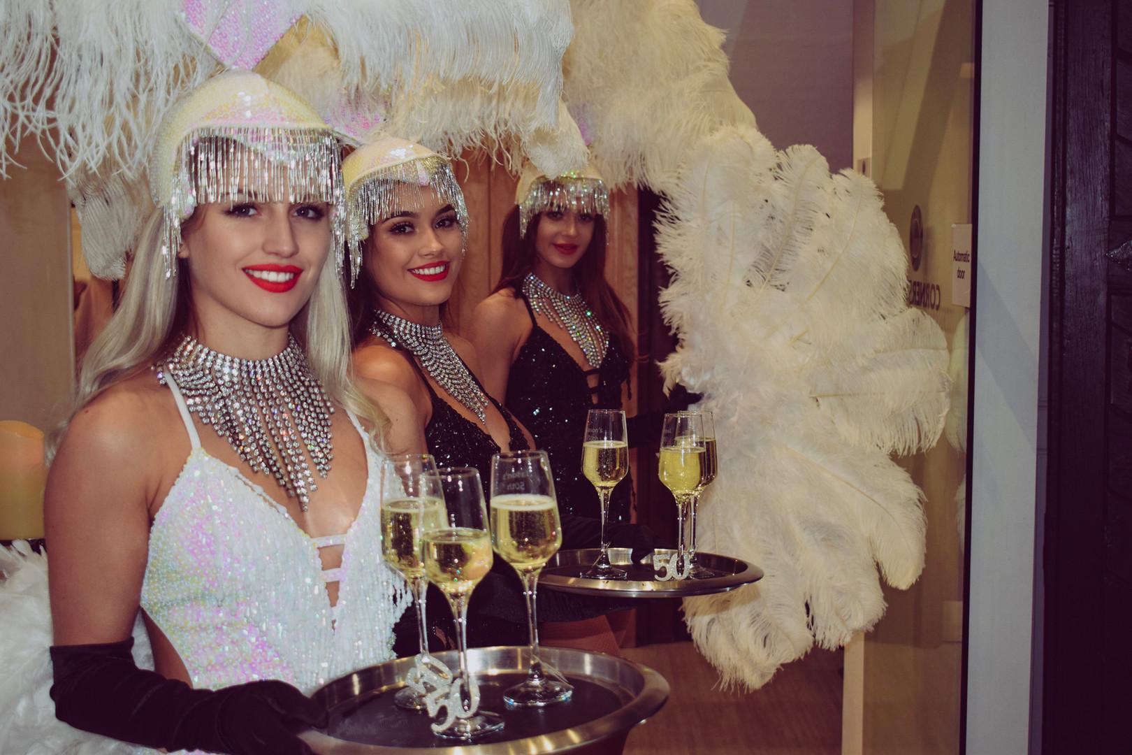 Showgirls serving a Prosecco Reception