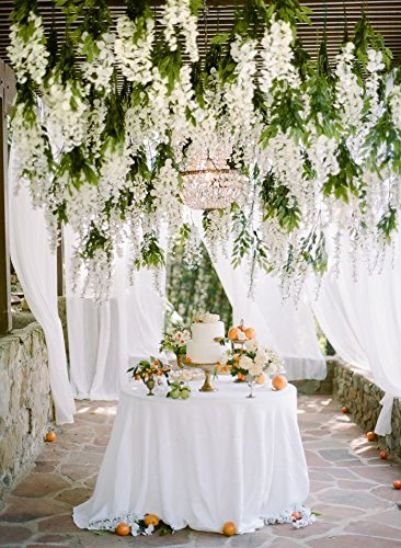 Ceiling covered with hanging flower arrangement