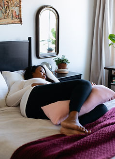 Pregnant mother using The Chase Pillow for comfortable sleep.