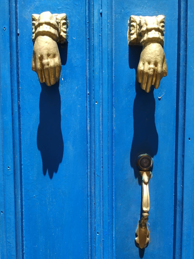 Portuguese door knockers hands