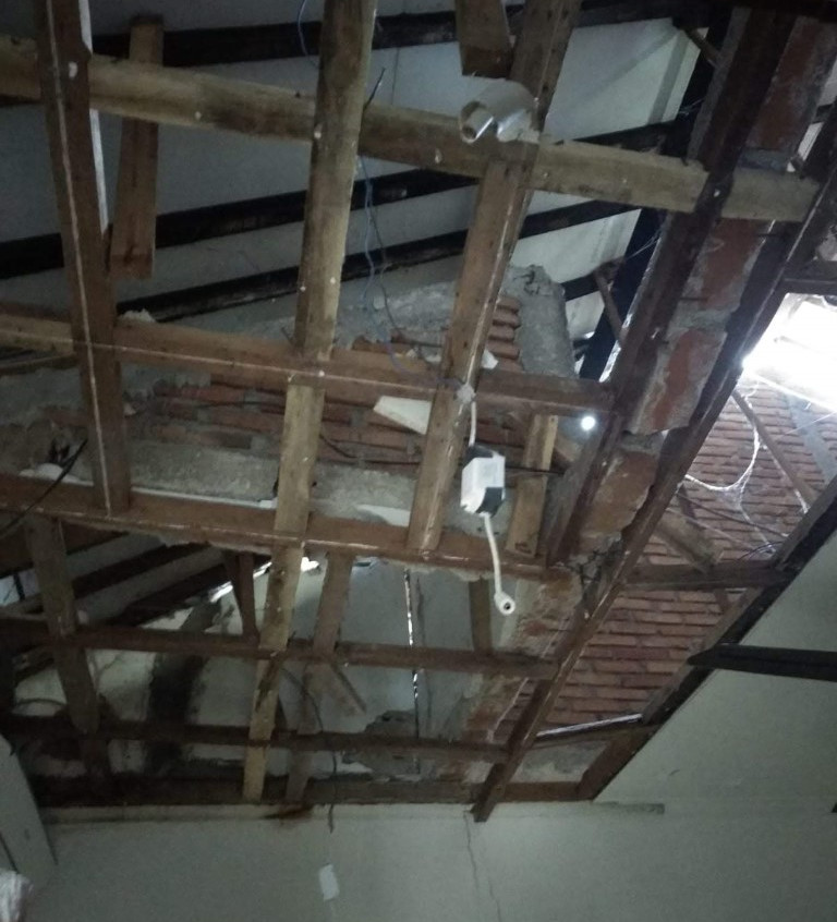 There were spines of brick along the rafters, all of which collapsed