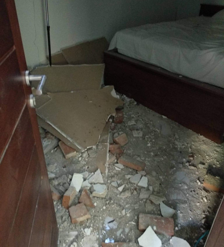 The ceiling collapsed in our bedroom, missing the bed but hitting the clothes rack and dresser