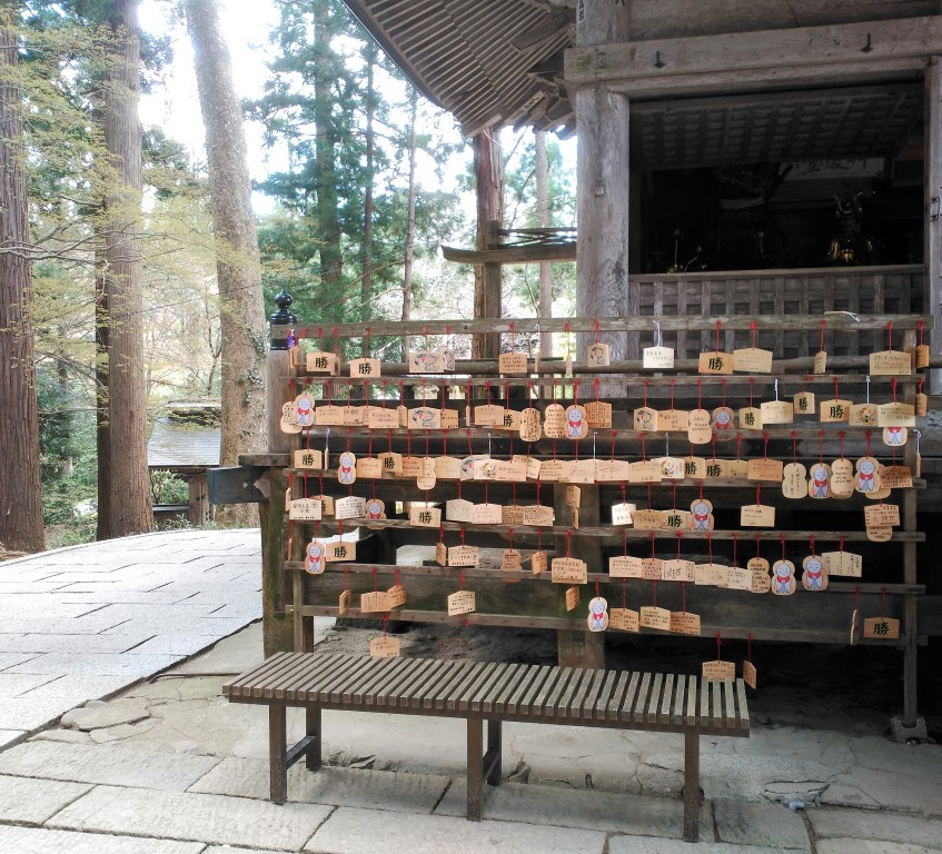 Wooden prayer panels. They are ceremonially burned when the racks become full, sending the prayers up to the gods.